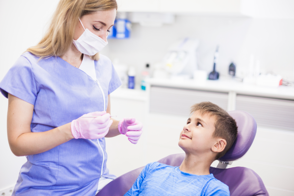 child visiting a dentist